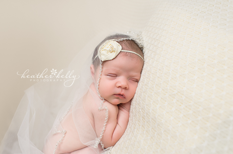 newborn girl with mom's wedding veil  newborn photography bethel ct