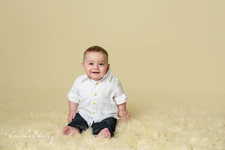 sitting baby boy during 6 month milestone session