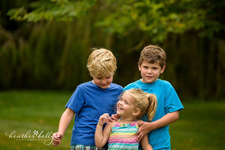 outtake of three siblings in newtown park