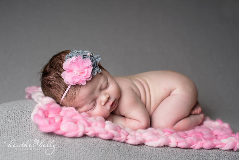 newborn photography session of baby girl on pink and gray