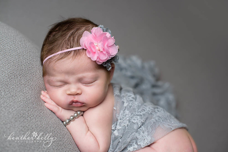 newborn girl on gray blanket photography session
