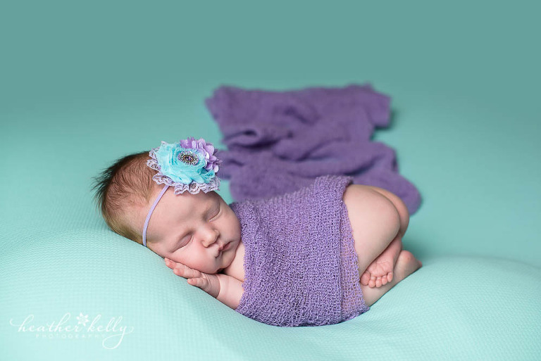aqua and purple baby girl with professional newborn photographer