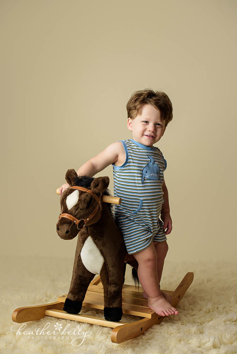 17 month old boy on toy horse