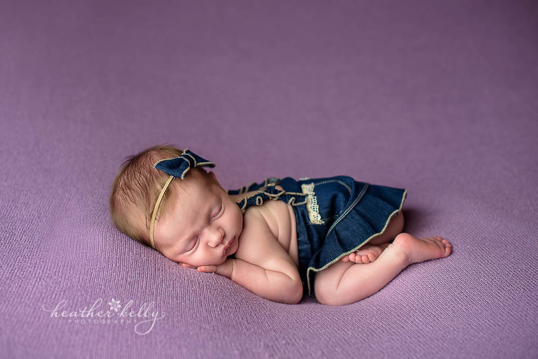 newborn girl with denim skirt