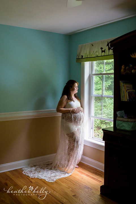 maternity photography in baby's nursery