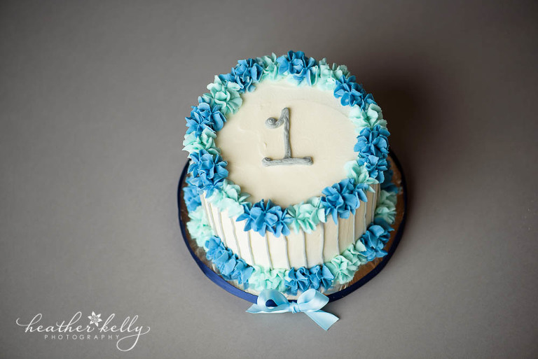 white, blue and gray first birthday cake