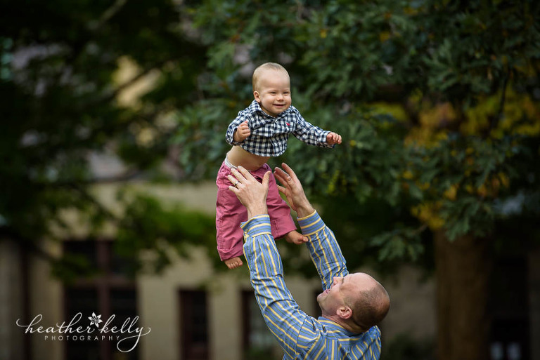 dad throwing one year old in air