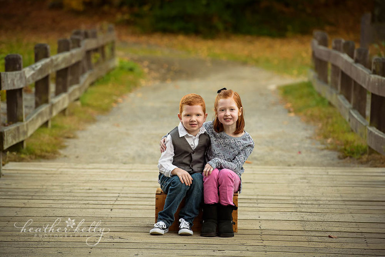 brother and sister on bridge photo
