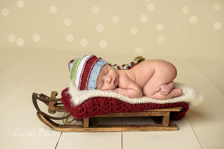 trumbull ct adorable Christmas themed newborn on a sled photo
