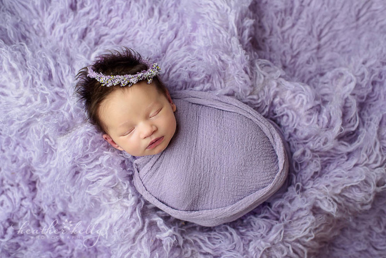 newtown newborn girl photo wrapped in lavender on flokati