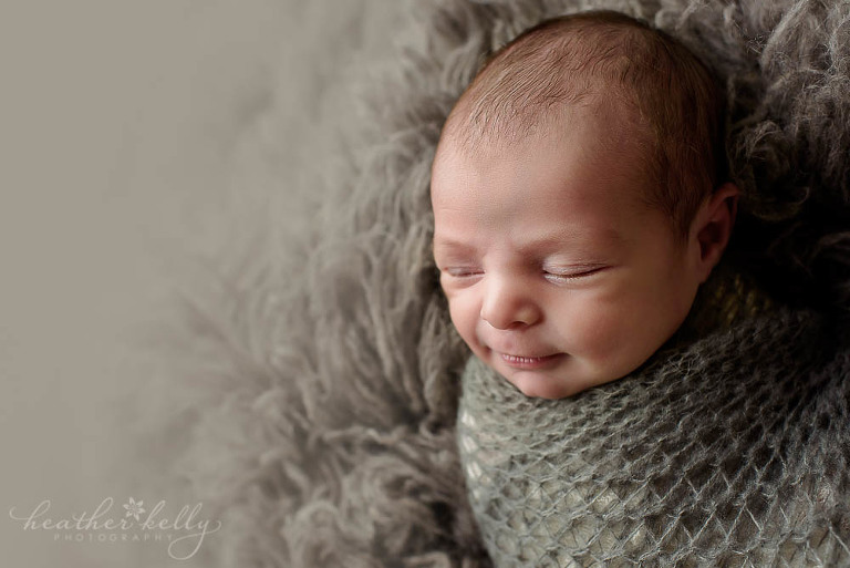 newborn boy wrapped in gray norwalk newborn photography ct