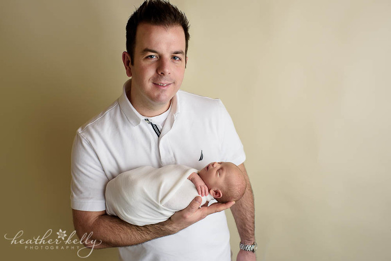 dad holding newborn baby photo adorable monroe newborn