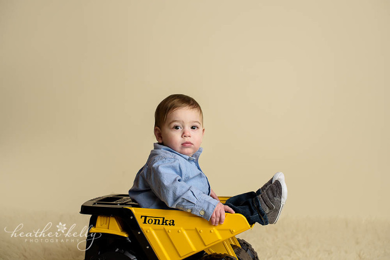 adorable danbury baby boy sitting in his tonka truck photo