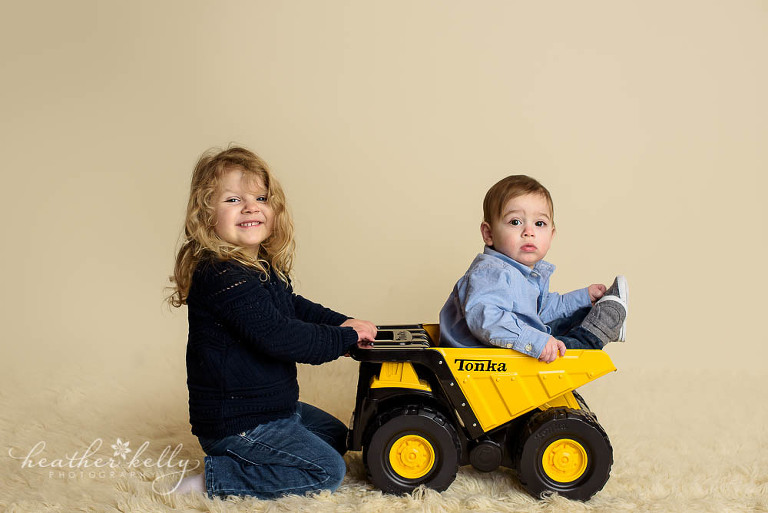 adorable danbury baby with his big sister in tonka truck photo