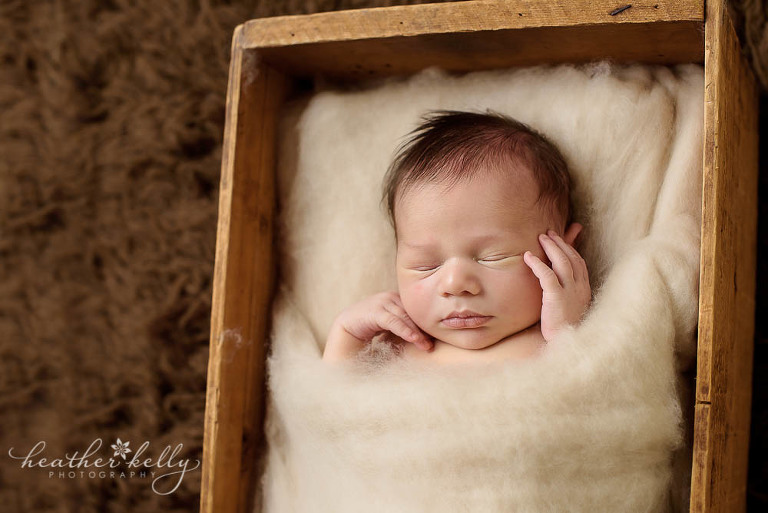 favorite prop pose photo of little boy tucked in crate newborn blog circle