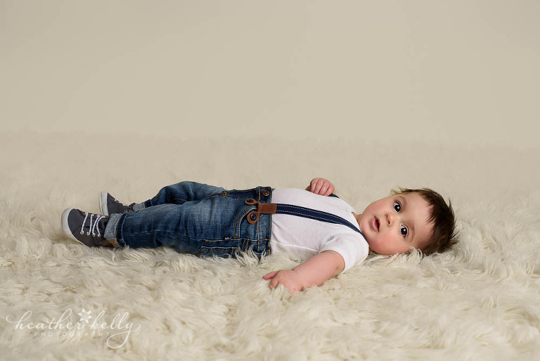 6 month boy laying on cream rug photo monroe baby photos