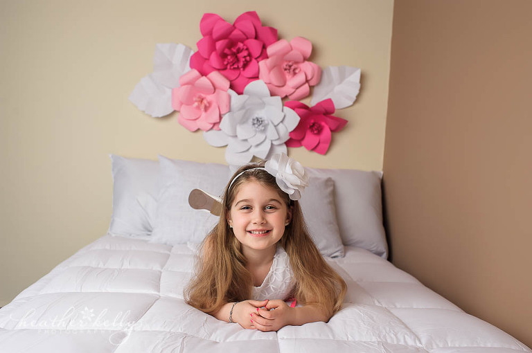ct child photographer | girl on bed photo with paper flowers | newtown newborn photos