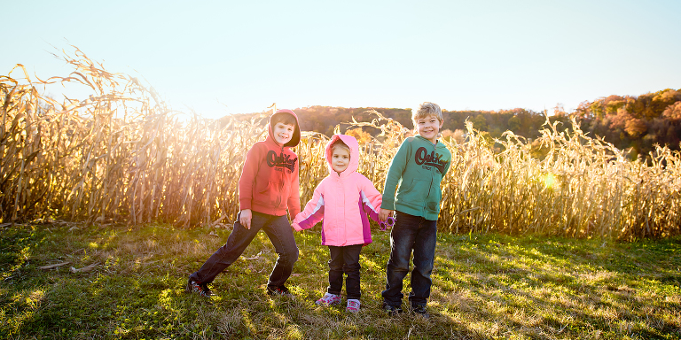 Heather Kelly Photography | CT family photographer. Photo of 3 kids in field.