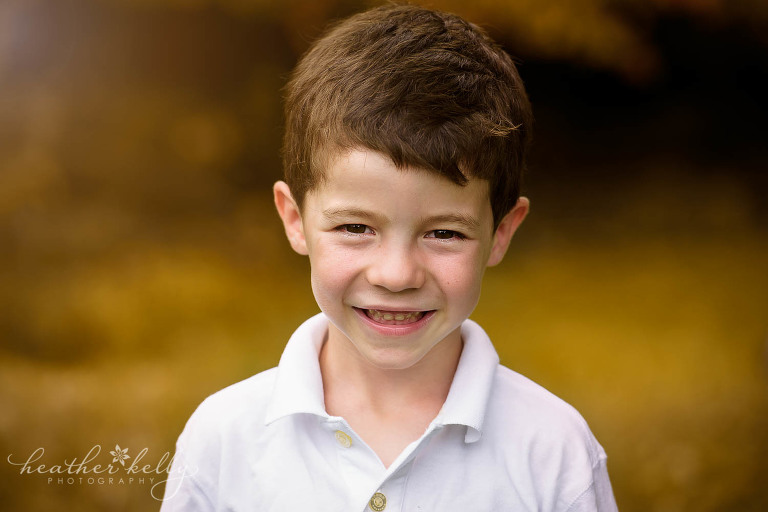 outdoor fall portrait of boy. new canaan family photos ct photography