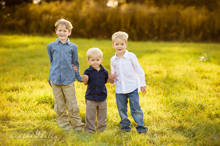 three brothers holding hands. ct family photography. now booking spring 2017 family sessions in ct.