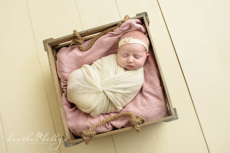 baby girl in crate pink. newtown newborn girl. ct photography