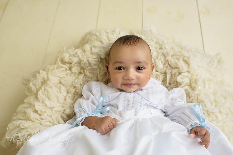 boy in baptism gown and basket for photo session
