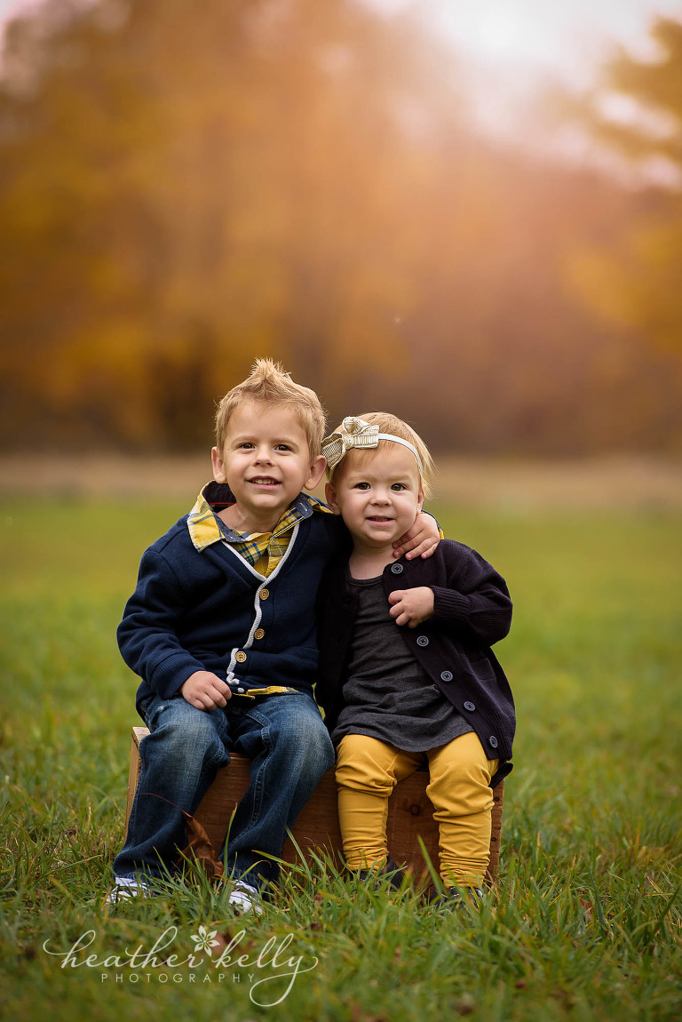 siblings photo on crate. fall family photography ct