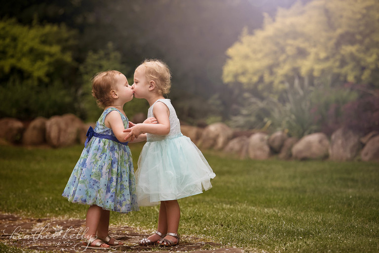 toddler sisters kissing. family photography danbury ct