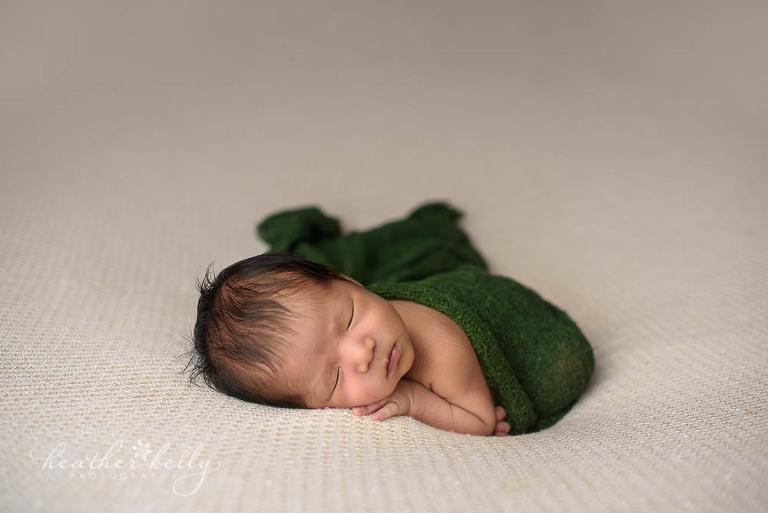 Norwalk ct newborn talen newborn boy with dark green wrap photo
