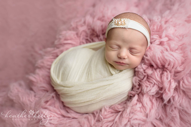 Pink and ivory wrapped newborn girl newborn wrapping poses