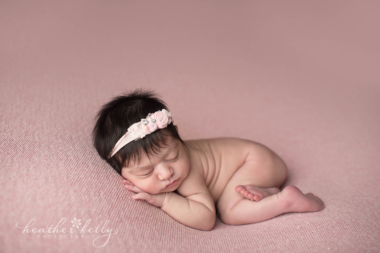 Snuggled newborn photography on pink milford ct